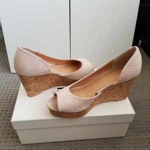 Blush peep toe wedge pumps